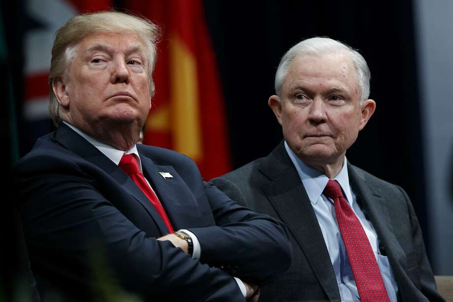 President Trump (left) sits with Attorney General Jeff Sessions during the FBI National Academy graduation ceremony held in Quantico, Va. Photo: Evan Vucci, Associated Press