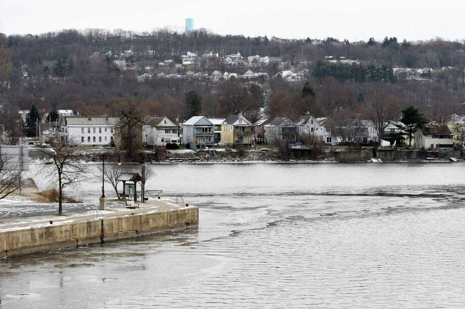 Ice begins to form on the banks of the Hudson at the confluence of the Mohawk River on Friday, Dec. 15, 2017, in Waterford, N.Y.  (Will Waldron/Times Union) Photo: Will Waldron, Albany Times Union