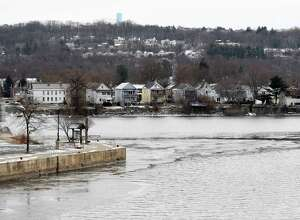 Ice begins to form on the banks of the Hudson at the confluence of the Mohawk River on Friday, Dec. 15, 2017, in Waterford, N.Y.  (Will Waldron/Times Union)