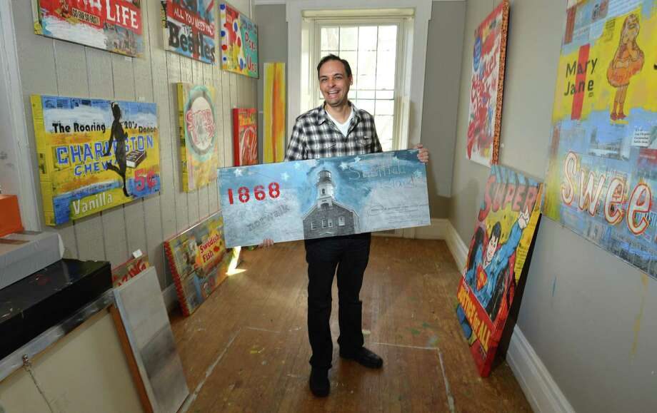 Norwalk artist Dave Morico holds one of his mixed media peices, Sheffield Island, surrounded by other works in his Pop-art series at his studio in the St. Philip Artists' Guild in Norwalk Conn. on Wednesday December 6, 2017. Photo: Alex Von Kleydorff / Hearst Connecticut Media / Norwalk Hour