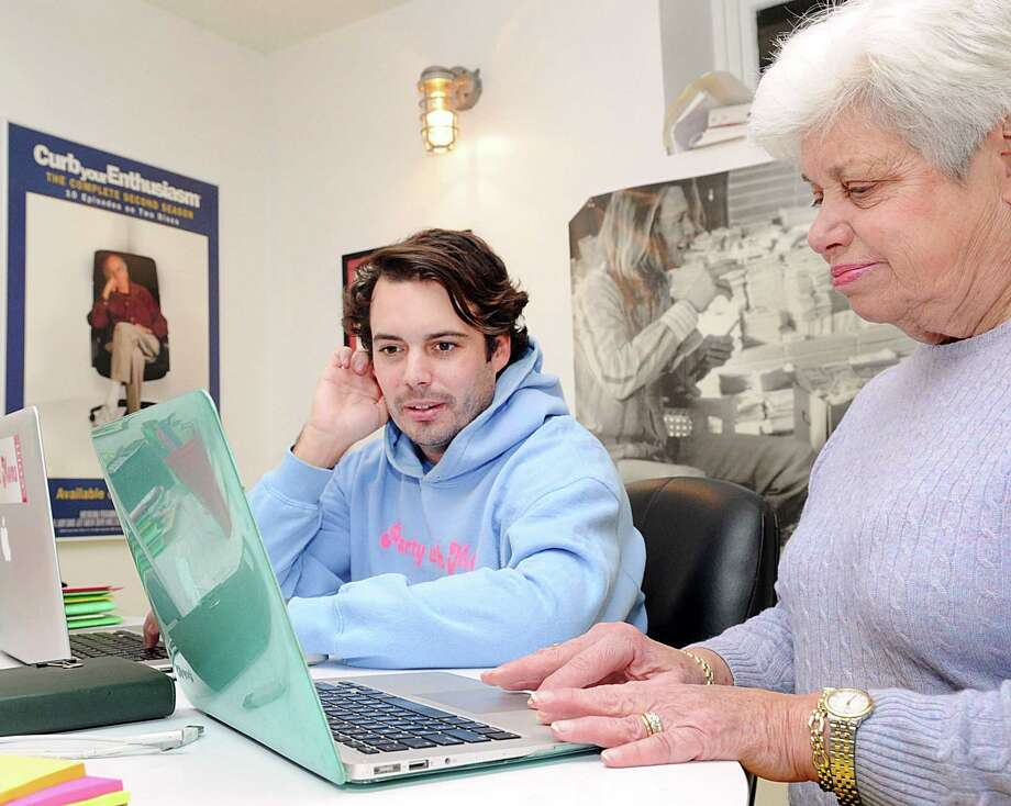 Remy Cook, Party with Moms founder, left, with his godmother and partner Marianne Riess at their office in Greenwich, Conn., Friday, Dec. 1, 2017. Party with Moms is a website that focuses on celebrating and serving Moms with original content. Riess is also a columnist for the website. Photo: Bob Luckey Jr. / Hearst Connecticut Media / Greenwich Time