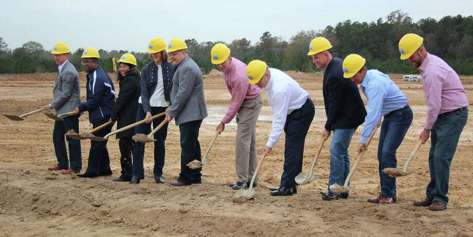 The groundbreaking ceremony for Big Rivers Waterpark and Gator Bayou Adventure Park took place on Dec. 14 off of SH 242 in New Caney. Pictured left to right are North Avenue Capital Chief Executive Ben Chatraw, Big Rivers Waterpark Director of Operations Charlie Martin, Big Rivers Waterpark General Manager Sonia Munoz-Gill, Grand Texas board member Patsy Ward, Grand Texas Chief Executive Officer Monty Galland, Grand Texas Chairman of the Board Max Bachrach, East Montgomery County Improvement District President-CEO Frank McCrady, SME Advisors Principal Bill Hartley, Solid Bridge Construction President Vance Bridges and Project Manager Travis Hanus. Photo: Jacob McAdams