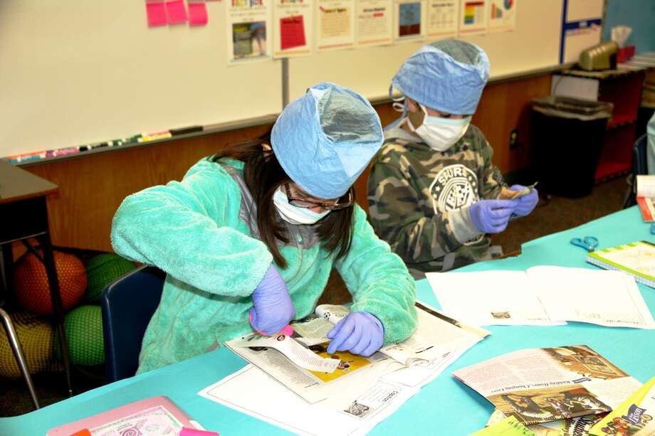Edgemere Elementary fourth grade students Alyssa Riojas and Elijah Valdez examine newspapers and magazines to dissect the text features. Photo: Jan Seago, Plainview ISD