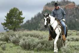 """In this May 9, 2017, photo, Interior Secretary Ryan Zinke rides in the Bears Ears National Monument with local and state representatives in Blanding, Utah. Zinke is strongly disputing a claim by outdoor retailer Patagonia that President Donald Trump """"stole"""" public land by shrinking two national monuments in Utah."""