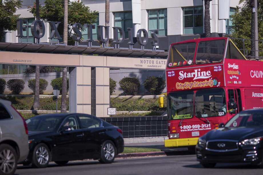 A tour bus passes the main entrance to Fox Studios after the Walt Disney Company announced that it will acquire 21st Century Fox on December 14, 2017 in Los Angeles, California. The deal includes Twentieth Century Fox Film and Television studios, and cable and international TV businesses for $52.4 billion in stock, and is expected to result in a large number of layoffs. Photo: David McNew /Getty Images / 2017 Getty Images