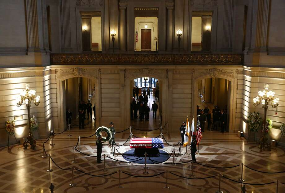 An honor guard circles the casket containing the body of Mayor Ed Lee lying in repose in the San Francisco City Hall rotunda, on Friday, Dec. 15, 2017, in San Francisco.   Lee died early Tuesday after collapsing at a grocery store, leaving the city reeling from shock and dealing with the logistics of selecting a new leader. (Michael Macor/The San Francisco Chronicle via AP, Pool) Photo: Michael Macor, Associated Press