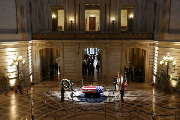 An honor guard circles the casket containing the body of Mayor Ed Lee lying in repose in the San Francisco City Hall rotunda, on Friday, Dec. 15, 2017, in San Francisco.   Lee died early Tuesday after collapsing at a grocery store, leaving the city reeling from shock and dealing with the logistics of selecting a new leader. (Michael Macor/The San Francisco Chronicle via AP, Pool)