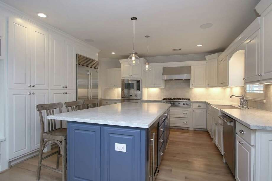 This remodeled kitchen is part of whole-house award-winning project. Photo: Courtesy Of Remodelers Of Houston