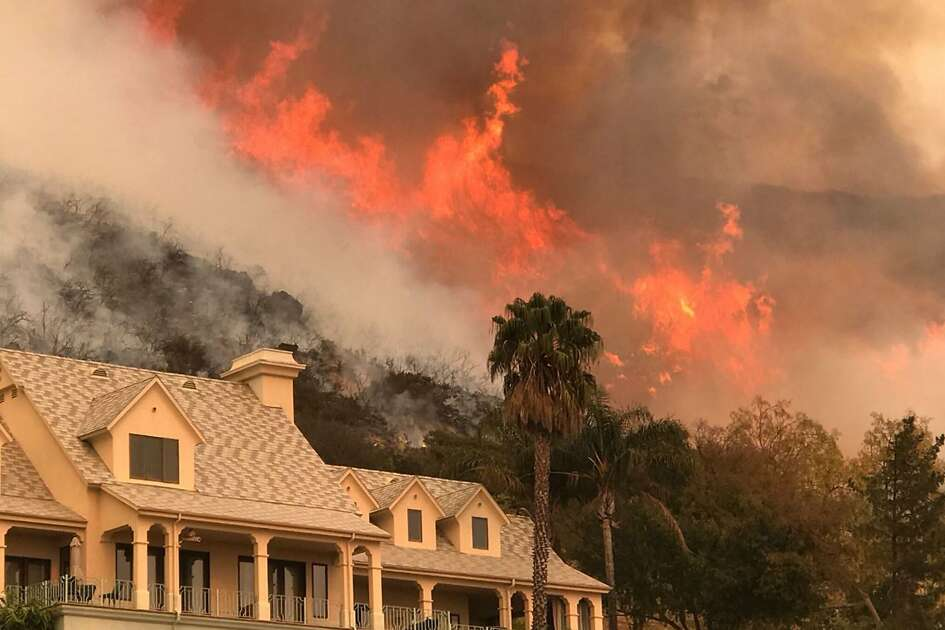 "This undated photo obtained from the Santa Barbara County Fire, shows flames from the Thomas Fire near homes. San Diego-based Cal Fire engineer Cory Iverson died fighting the Thomas Fire in Ventura County, according to Cal Fire Chief Ken Pimlott on December 14, 2017, but gave no further details on the incident. Emergency services spent another day struggling to contain infernos across the tinder-dry state. / AFP PHOTO / Santa Barbara County Fire / HO / RESTRICTED TO EDITORIAL USE - MANDATORY CREDIT ""AFP PHOTO / Santa Barbara County Fire"" - NO MARKETING NO ADVERTISING CAMPAIGNS - DISTRIBUTED AS A SERVICE TO CLIENTS  HO/AFP/Getty Images"