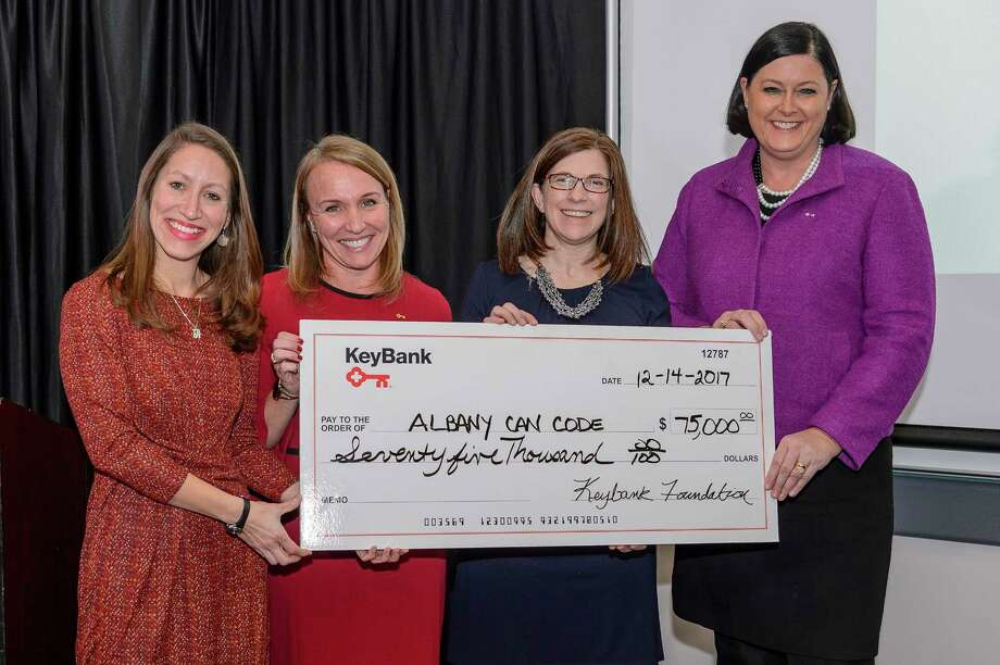 KeyBank on Thursday donated $75,000 to AlbanyCanCode to support its Employer Engagement Program. Pictured from left to right is Annmarie Lanesey, board chair and founder of AlbanyCanCode; Kelli Arnold, director of corporate responsibility for KeyBank; Janet Carmosky, executive director of AlbanyCanCode and Ruth Mahoney, president of KeyBank's Capital Region operations. Photo: VINCENT GIORDANO For HVCC, KeyBank / Copyright 2017 Hudson Valley Communty College