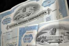 General Motors Corp. stock certificates are seen in North Andover, Mass. While not a financial gift in the traditional sense, a framed antique stock certificate can be a unique gift.