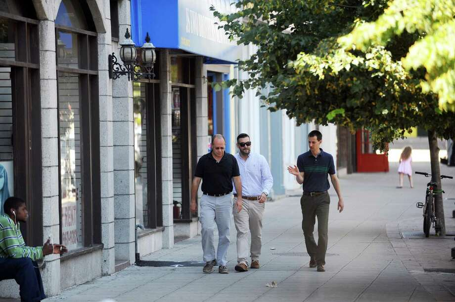 People walk down Atlantic St. in downtown Stamford, Conn. on Wednesday, June 21, 2017. Photo: Michael Cummo / Hearst Connecticut Media / Stamford Advocate