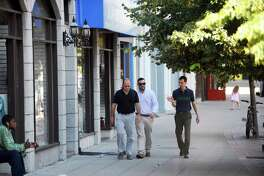 People walk down Atlantic St. in downtown Stamford, Conn. on Wednesday, June 21, 2017.