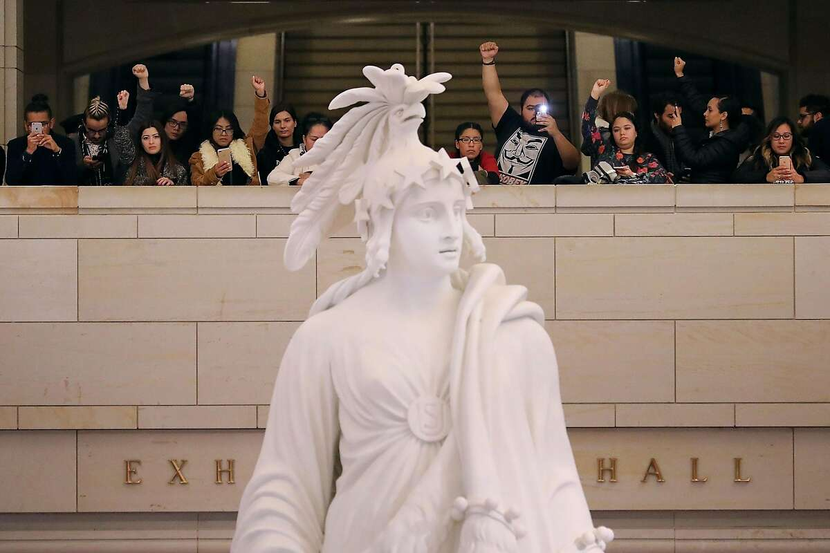 WASHINGTON, DC - DECEMBER 07: Demonstrators from The Seed Project stage a protest in the U.S. Capitol Visitors Center to demand immigration reform and a renewal of the Deferred Action for Childhood Arrivals (DACA) program December 7, 2017 in Washington, DC. Made up of undocumented immigrant youth or 'dreamers,' The Seed Project is in the nation's capitol 'to say that we won't accept a government budget without protection for all undocumented youth.' (Photo by Chip Somodevilla/Getty Images)