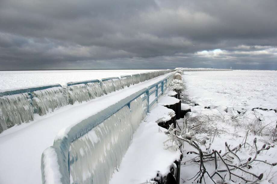 A calm set in around the Port Austin area Thursday, following a blustery, snow-filled Wednesday. Things were especially picturesque along the Port Austin breakwall, where icicles pulled out the full beauty of the lovely surroundings. Photo: Seth Stapleton/Huron Daily Tribune