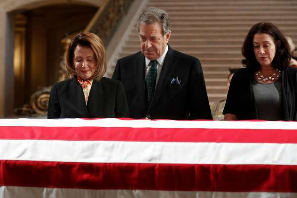 Nancy Pelosi, the Minority Leader of the United States House of Representatives with her husband Paul and daughter Christine at the casket containing the body of Mayor Ed Lee lying in state in the San Francisco City Hall rotunda, on Friday December 15, 2017, in San Francisco, Ca.