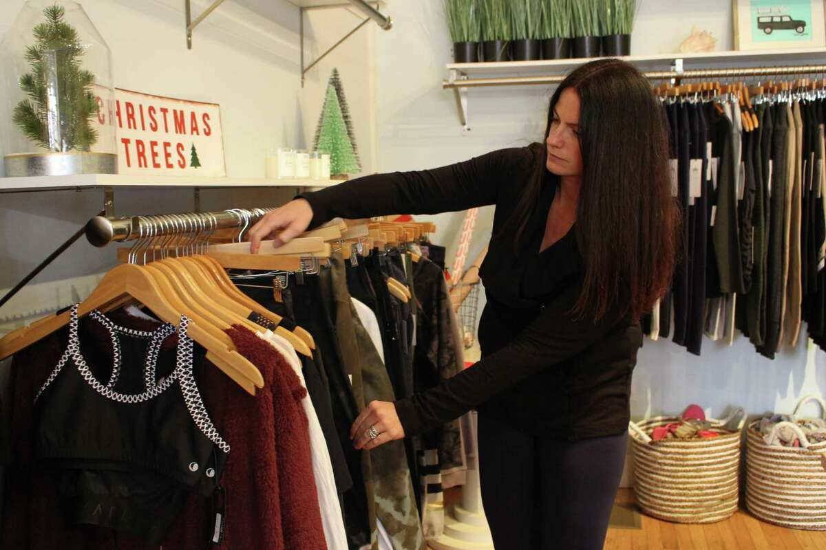 Co-owner Kelly McGee at women?'s swimwear retailer Swim N Surf in Fairfield, which has received financial assistance from the town.