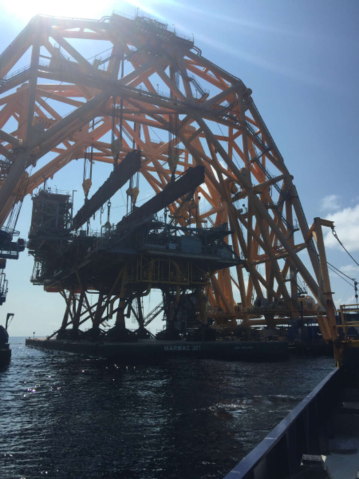 Cranes remove the topsides of Royal Dutch Shell's 36-year-old Cougar oil and gas platforms.