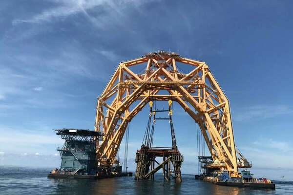 A heavy lift vessel hauls Royal Dutch Shell's 36-year-old Cougar oil and gas platform 50 miles across the Gulf of Mexico to a site where it will be lowered into the ocean to become an artificial reef about 110 miles off the coast of Louisiana.