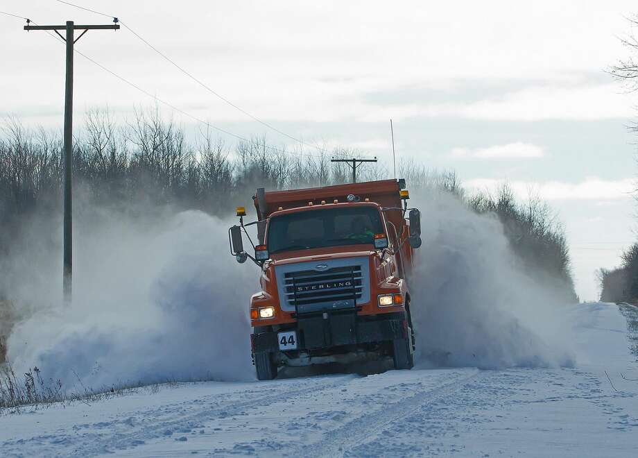 Huron County Road Commission road crews were hard at work clearing snow and ice from county roadways following a recent snowfall. Photo: Bill Diller/For The Tribune