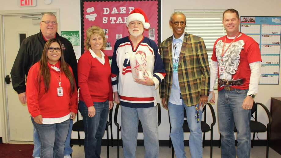 Richard Ritchey (center) accepts congratulations and prizes from well-wishers after being named Cleveland ISD teacher of the week. The award is sponsored by Jeff McClain with KORG FM, El Burrito, Easy Street Florist, Anderson Ford Quick Lane Tire and Auto, and Chef's House. Photo: Submitted