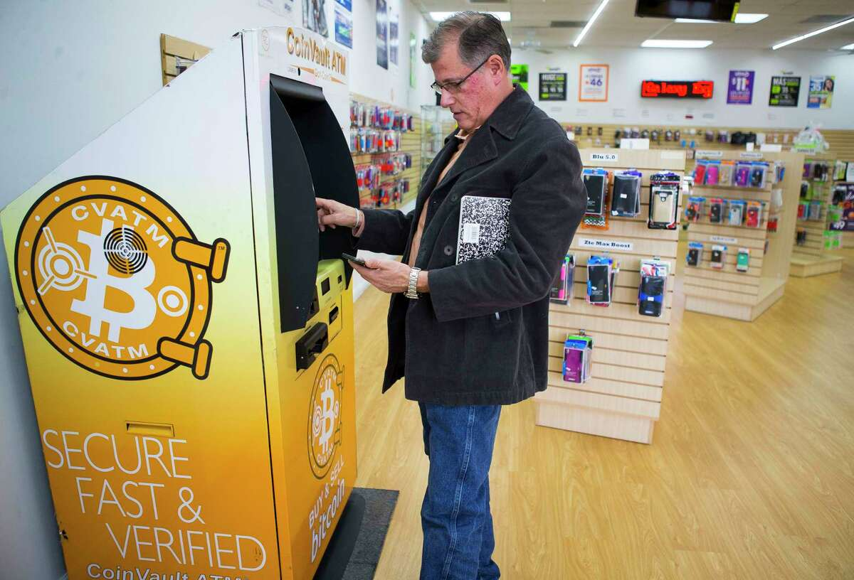 Sheldon Weisfeld purchases $20 worth of Bitcoin from one of the CoinVault ATM machines he operates in the Houston area, this one at Smartphone Repair on Harwin Drive, Wednesday, Dec. 13, 2017, in Houston. Weisfeld operates three ATMs in the area that allow users to buy and sell Bitcoin. ( Mark Mulligan / Houston Chronicle )