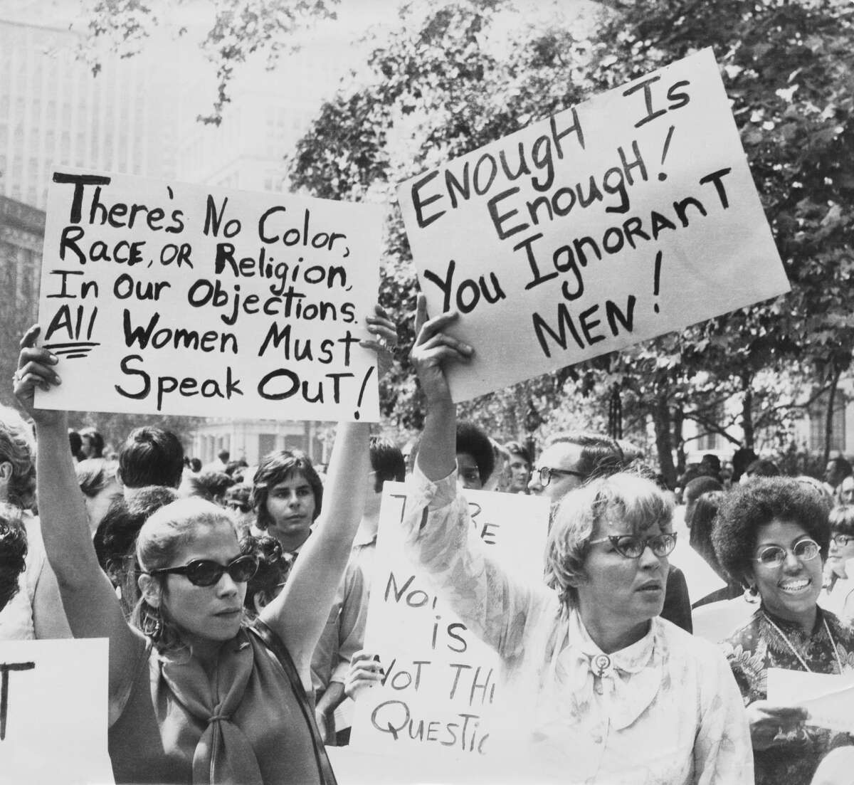 Women hold up signs demanding equal rights during a demonstration for women's liberation, New York City.