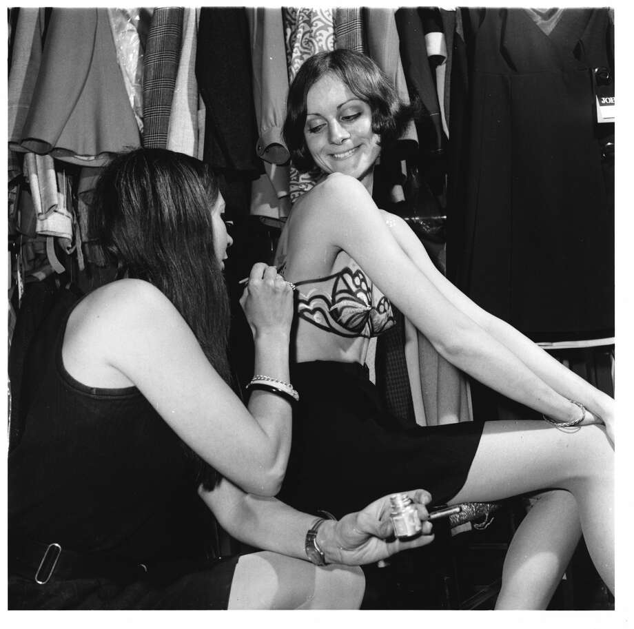 The freelance designer Audrey Watson, gives her client, Janice Everett, an 'Instant Bra' using body paints, at the Lady Jayne Boutique. This was designed so women can wear a transparant top without underwear. 1968. Photo: Hulton Deutsch/Corbis Via Getty Images