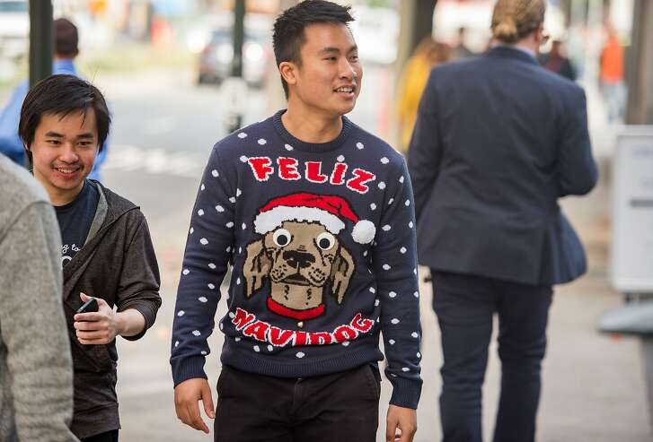 Howard Nguyen wears a Christmas sweater during National Ugly Christmas Sweater Day in San Francisco on December 15, 2017.