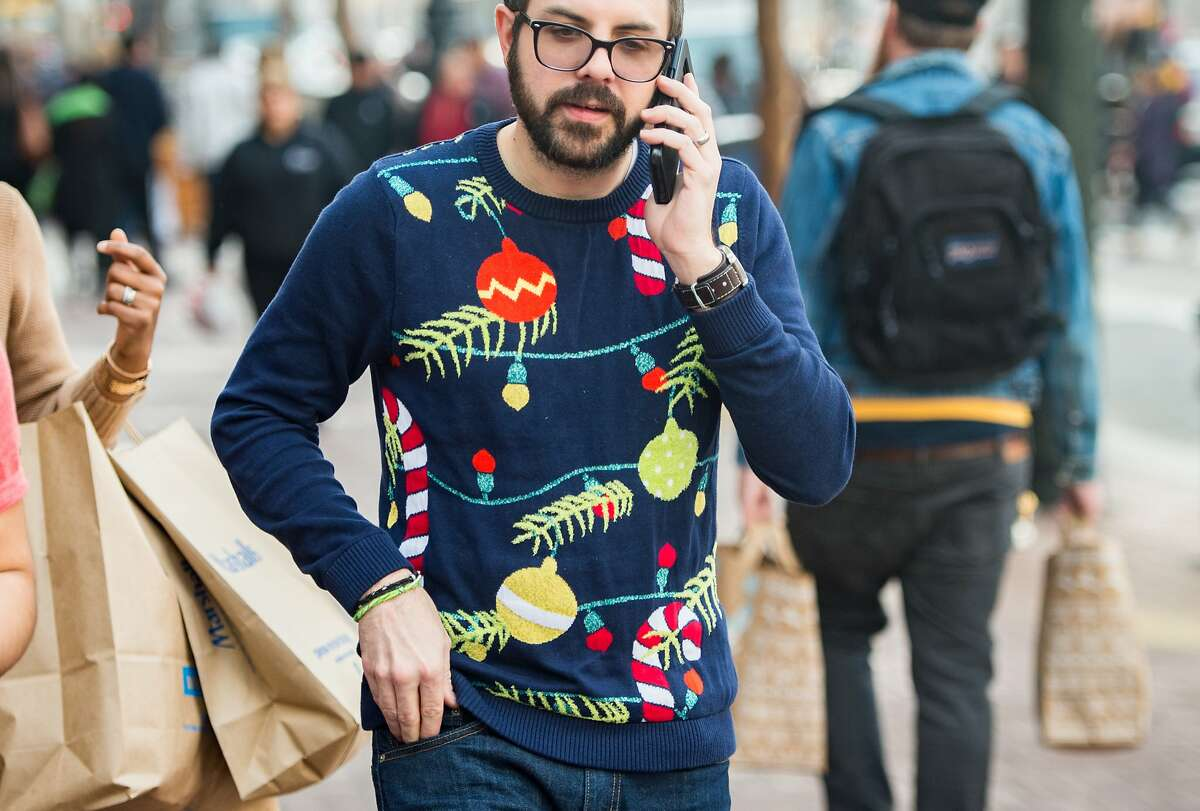 Graham Lajoi wears a Christmas sweater during National Ugly Christmas Sweater Day in San Francisco on December 15, 2017.