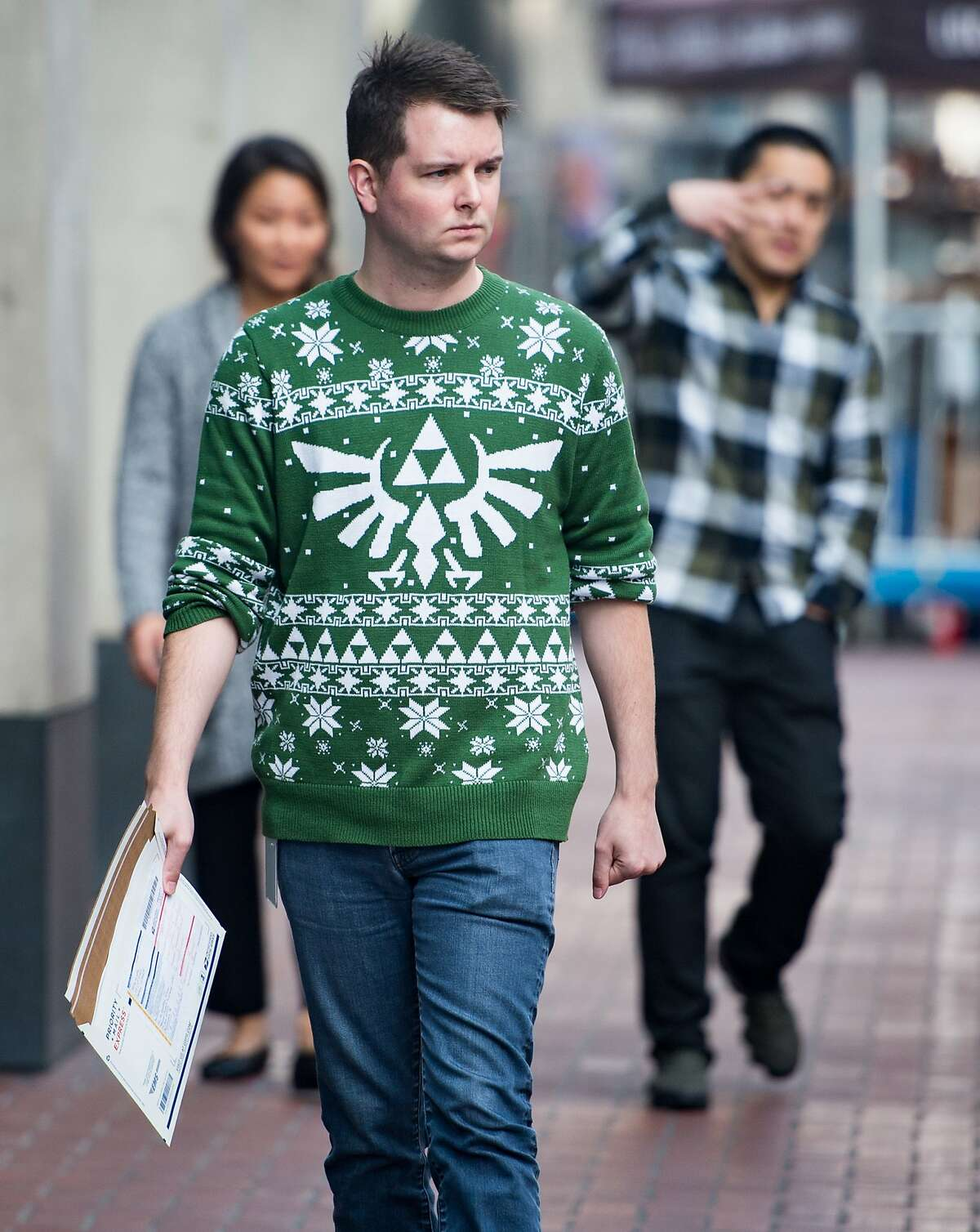 Taylor Huckaby wears a video game-themed Christmas sweater during National Ugly Christmas Sweater Day in San Francisco on December 15, 2017.