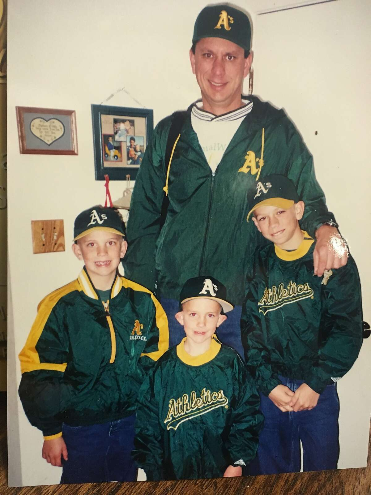 New Oakland outfielder Stephen Piscotty, right, grew up going to A's games with his father, Michael, and brothers Nick (left) and Austin (front).