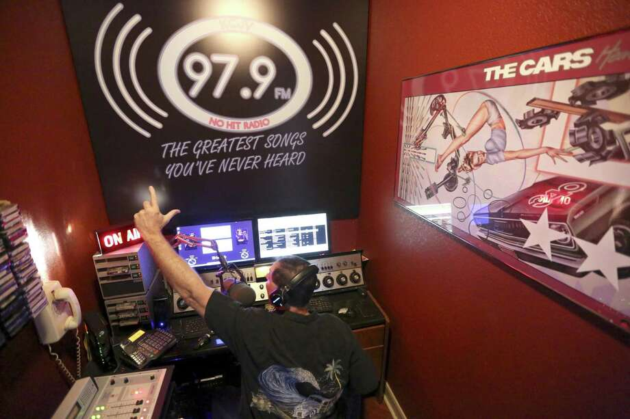 "KCJV radio owner Chris Varelas re-creates one of his favorite DJ scenes from ""American Graffiti"" in his home broadcast studio. KCJV is a low-power radio station that plays rarely heard oldies, many from long-forgotten San Antonio groups. Photo: William Luther /San Antonio Express-News / © 2017 San Antonio Express-News"