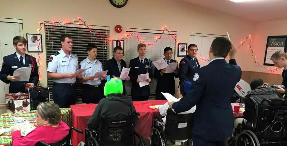 Splendora Air Force JROTC cadets sing out a Christmas tune for the residents ofPine Shadow Retreat Assisted Living Facility in Porter. Photo: Submitted