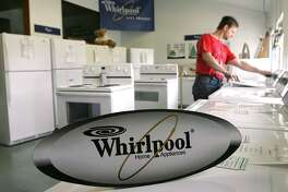 Dan Louzon shops for a Whirlpool washing machine in Garden City, Mich., in 2005. The manufacturer is asking the U.S. to impose tariffs on imported washing machines.