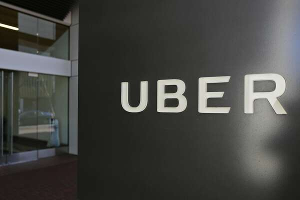 FILE - This Wednesday, March 1, 2017, file photo shows an exterior view of the headquarters of Uber in San Francisco. A top Uber lawyer struggled to explain to a federal judge why the ride-hailing service reached a $7.5 million settlement with a former employee accusing it of stealing its rivals� trade secrets, even though management considered the allegations to be a bogus attempt to blackmail the company. (AP Photo/Eric Risberg, File)