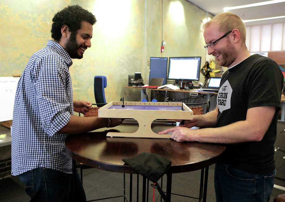 Nitin Chaudhary and Josh Davidson play Klask during a break at Ruths AI in downtown on Friday, Nov. 10, 2017, in Houston. ( Elizabeth Conley / Houston Chronicle ) Photo: Elizabeth Conley, Staff / © 2017 Houston Chronicle