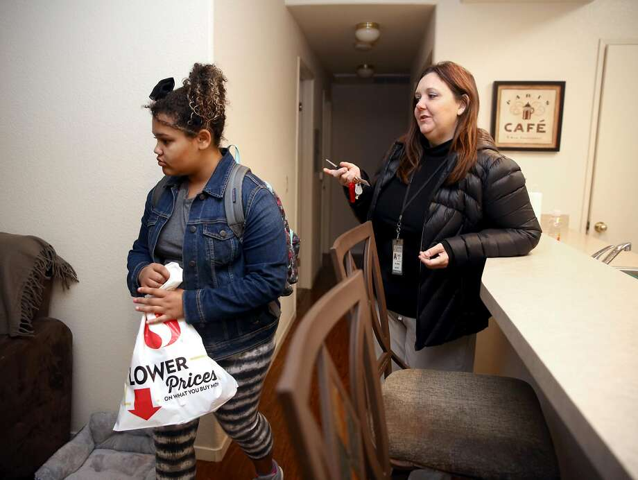 Amy Marlar (right), with daughter, Logyn, 11,  lost her Section 8 subsidized rental unit in the fire. Child care and rent for their new apartment has increased her monthly costs by $1,500. Photo: Liz Hafalia, The Chronicle