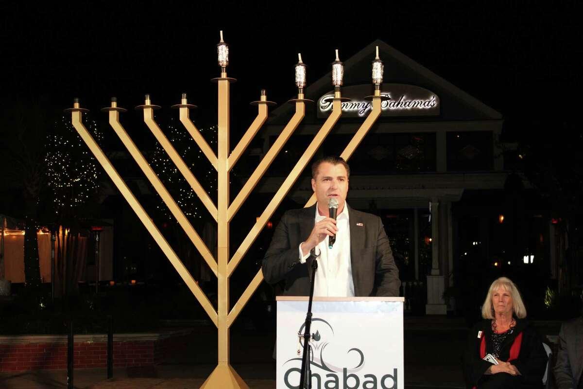 Gordy Bunch speaks during the menorah lighting ceremony at TheGrand Chanukah Celebration at Market Street on Dec. 14.