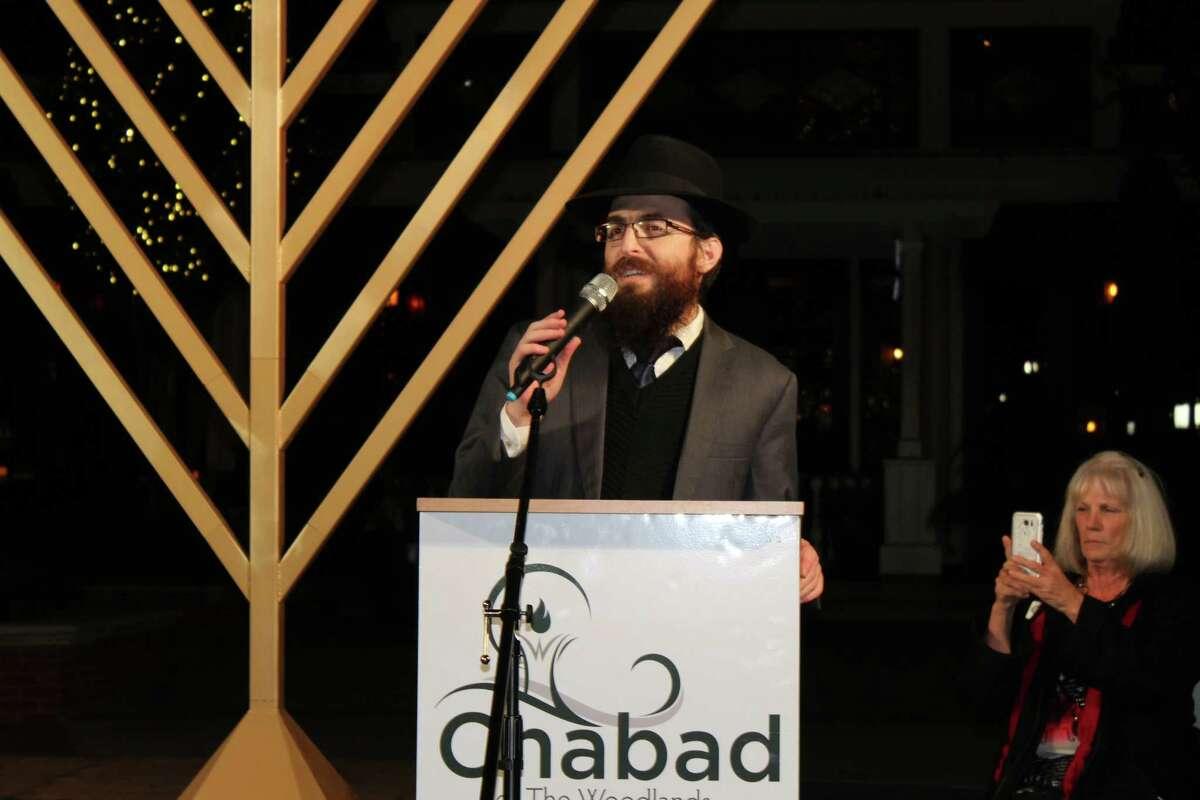 Rabbi Mendel Blecher spoke about the history of Hanukkah and lit the menorah at TheGrand Chanukah Celebration at Market Street on Dec. 14.