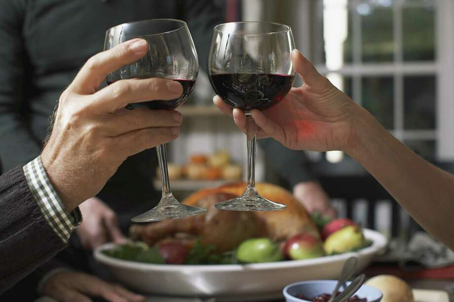 Drinking is part of the holidays, but overindulging can spoil the spirit of good cheer. Photo: /© Corbis / Â Corbis. All Rights Reserved.