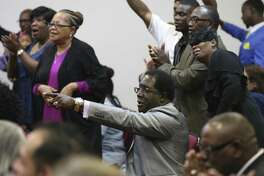 Jarvis Moore attends services at Victory Gospel Church in the city's Eastside, Sunday, Dec. 3. Moore, a convicted murderer, has since dedicated his life preaching to and hiring ex-convicts.