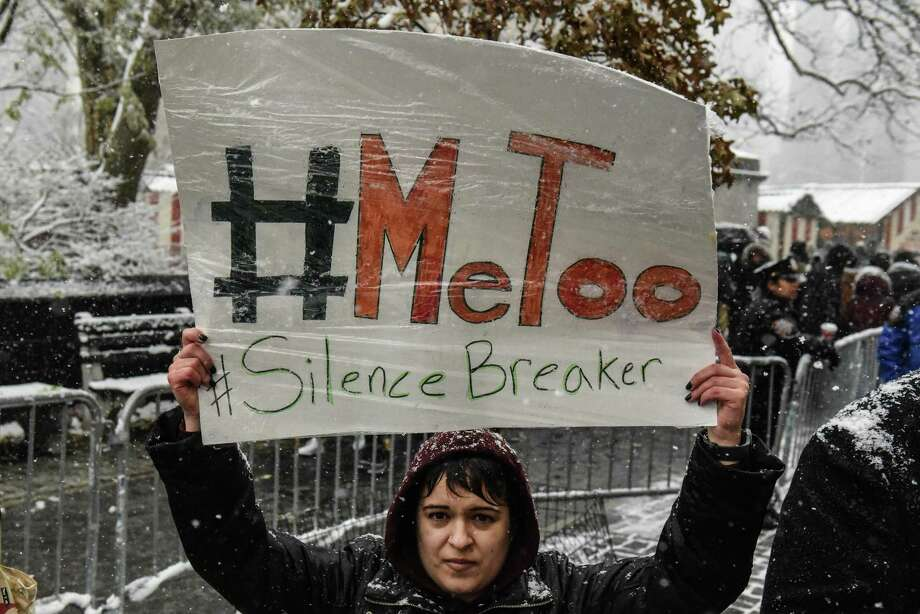 Protesters address the issue of sexual harassment at a #MeToo rally Dec. 9 in New York City. Title VII of the Civil Rights Act contains protections for women who speak out on harassment. Photo: Stephanie Keith /Getty Images / 2017 Getty Images