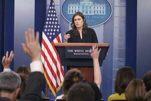 White House Press Secretary Sarah Huckabee Sanders speaks to the media during her daily press briefing at the White House on Dec. 12. In exchanges with reporters, the press secretary seems to conflate honest mistakes made by journalists with journalistic bias.