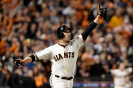 SAN FRANCISCO, CA - OCTOBER 16:  Travis Ishikawa #45 of the San Francisco Giants celebrates after he hits a three-run walk-off home run to defeat the St. Louis Cardinals 6-3 during Game Five of the National League Championship Series at AT&T Park on October 16, 2014 in San Francisco, California.  (Photo by Thearon W. Henderson/Getty Images)