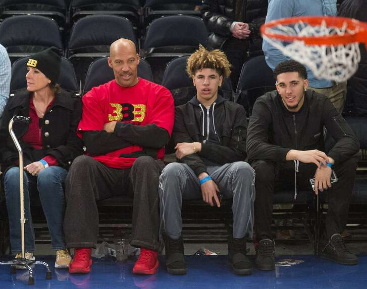 From left, Tina Ball, LaVar Ball, LaMelo Ball and LiAngelo Ball look on as the New York Knicks welcome the Los Angeles Lakers to Madison Square Garden in New York on Tuesday, Dec. 12, 2017. (Howard Simmons/New York Daily News/TNS)