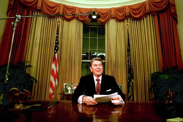 President Ronald Reagan is seen shortly after he delivered his farewell address to the nation at the Oval Office in the White House, Washington, on January 12, 1989. The situation has changed dramatically from the time Reagan signed tax cuts in the 1980s to the current economy.