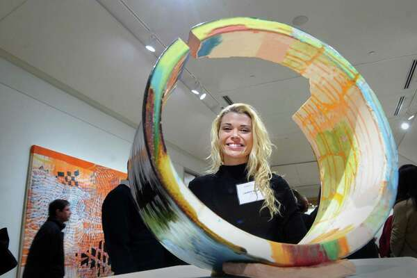 Philadelphia artist Lauren Mabry with one of her ceramic creations during the Flinn Gallery's opening night for the Venus Fly art show at the gallery located inside Greenwich Library, Conn., Thursday night, Dec. 14, 2017. The show features new abstract work by female artists, Becca Lowry, Mabry and Alyse Rosner and runs until January 24.