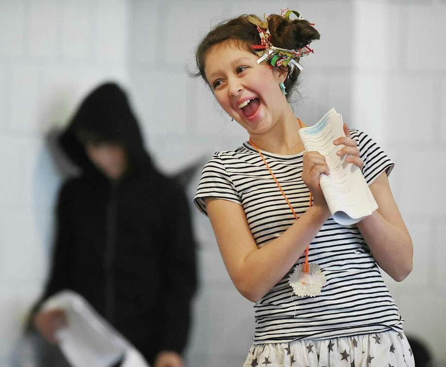 "Adelaide Morrissey as Cella, performs in ""Nightmare on Evil Street"" at the Long Wharf Theatre Stage II, Friday, Dec. 15, 2017, in New Haven. Adelaide, a student in Long Wharf Theatre's annual drama class for the CT Experiential Learning Center (CELC) Middle School of Branford and homeschooled students and her classmates, age 9-14, participated in a nine-week course collaborating on all aspects of the play including performance, direction and design. In the background is Lorenzo Dalton as the unamed character. Photo: Catherine Avalone / Hearst Connecticut Media / New Haven Register"