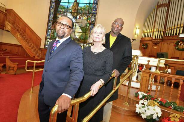 The Rev. DeWitt Stevens, Operations Manager Joleen Green and Rev. Michael Rumble stand on the stairs to the new raised pulpit at the Macedonia Church on Thursday December 14, 2017 in Norwalk Conn. The congregation purchased the 121-year-old building formerly First United Methodist Church on West Ave. in May of 2014, and have made extensive repairs and upgrades